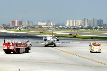 Jazz CRJ taxis in followed by fire trucks